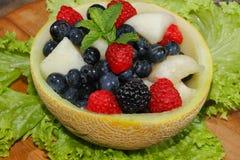 Galia melon, cantaloupe, raspberries, blackberries, blueberries Royalty Free Stock Image