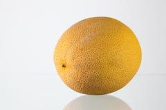 Galia melon on the glass desk Stock Photo