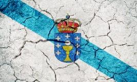 Galicia, autonomous community of Spain, flag. On dry earth ground texture background Stock Photos