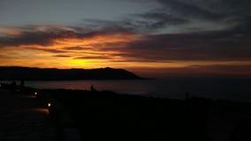 Galician night 2. Watching the sunset on the coast of galicia Stock Photos