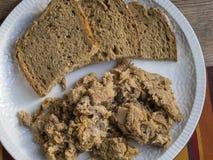 Galicianchicharrones med bröd royaltyfri fotografi