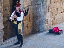 Galicische doedelzak busker - Santiago de Compostela stock foto