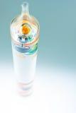 Galileo Thermometer Abstract colorido no azul imagem de stock royalty free