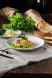 Galinha com couve e queijo na madeira Fotografia de Stock