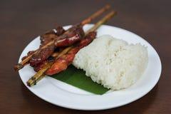 Galinha grelhada com arroz pegajoso imagem de stock royalty free