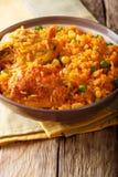 Galinhada is de Braziliaanse versie van arroz bedriegt pollokip Stock Foto's