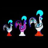 Galinhas portuguesas de néon no preto Fotografia de Stock