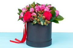 Gallant bouquet of pink and red roses and red ribbon in a circul. Ar black box. Valentines and anniversary concept Stock Photos