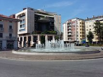 Fountain in Piazza San Lorenzo in Gallarate town in Italy. Gallarate, Varese / Italy - August 17 2018: Water jets, in the fountain shot by day in the city in Royalty Free Stock Photography