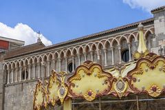Gallarate, Italy: San Pietro church. Gallarate, Varese, Lombardy, Italy: exterior of the medieval San Pietro church and a carousel stock photos