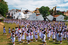 Galle, Sri lanka - 31 January, 2017: Fortress Galle, Sri Lanka, view on Shri Sudharmalaya Buddhist Temple school girls prac tice Royalty Free Stock Photos