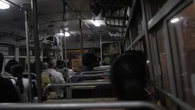 GALLE, SRI LANKA - JANUARY 13, 2017: Local people in bus looking through window. Trains are very cheap and poorly