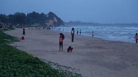 GALLE, SRI LANKA - MARCH 7, 2014: People having fun at beautiful sandy beach. Galle  is a popular destination for children, vendor stock video footage