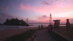 GALLE, SRI LANKA - MARCH 7, 2014: Small island connected with bridge at sunset. Galle  is a popular destination for children, vend stock video footage