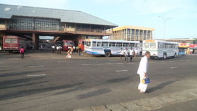 GALLE, SRI LANKA - MARCH 7, 2014: Timelapse of people and buses in front of central bus station. Buses are the main means of trans stock video