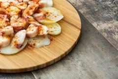 gallega lapulpo Galicianbläckfisk på trä Spansk mat Fotografering för Bildbyråer