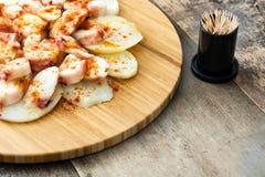 gallega lapulpo Galicianbläckfisk på trä Spansk mat Royaltyfria Bilder