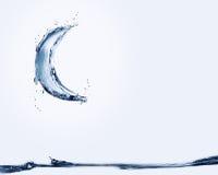 Galleggiamento della luna dell'acqua blu Fotografia Stock