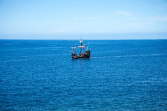 Galleon off Camara de Lobos is a fishing village near the city of Funchal and has some of the highest cliffs in the world Royalty Free Stock Photography