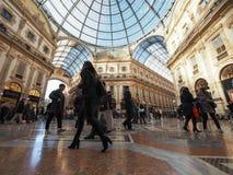 Galleria Vittorio Emanuele II arcade in Milan. MILAN, ITALY - CIRCA JANUARY 2017: Tourists in Galleria Vittorio Emanuele II shopping arcade Royalty Free Stock Photography