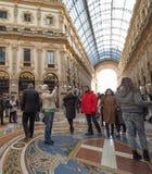 Galleria Vittorio Emanuele II arcade in Milan. MILAN, ITALY - CIRCA JANUARY 2017: Tourists in Galleria Vittorio Emanuele II shopping arcade Royalty Free Stock Image