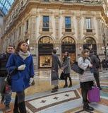 Galleria Vittorio Emanuele II arcade in Milan. MILAN, ITALY - CIRCA JANUARY 2017: Tourists in Galleria Vittorio Emanuele II shopping arcade Stock Images