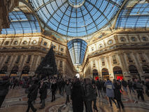 Galleria Vittorio Emanuele II arcade in Milan. MILAN, ITALY - CIRCA JANUARY 2017: Tourists in Galleria Vittorio Emanuele II shopping arcade Stock Image