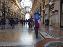 Galleria Vittorio Emanuele II arcade in Milan. MILAN, ITALY - CIRCA JANUARY 2017: Tourists in Galleria Vittorio Emanuele II shopping arcade Royalty Free Stock Photo