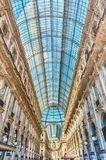 Galleria Vittorio Emanuele II, iconic shopping center in Milan,. MILAN - SEPTEMBER 11: Interior of Galleria Vittorio Emanuele II, iconic shopping center and Royalty Free Stock Images