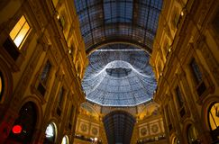 Glass skylight dome at arcade Galleria Vittorio Emanuele II illuminated with Christmas lights in Milan, Italy. royalty free stock image
