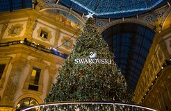 Galleria Vittorio Emanuele II in Milan with Christmas tree illuminated and lights, Italy. royalty free stock photography