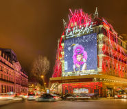 Galleries Lafayette in a Winter Night in Paris. Paris,France- December 21, 2014: Night aspect of Galleries Lafayette and The Haussmann Boulevard decorated for Royalty Free Stock Photography