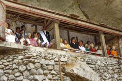 Galleries of tau-tau on balcony in Londa. Tana Toraja, South Sulawesi, Indonesia. Galleries of tau-tau on balcony guard the graves. Londa is cliffs and cave old Royalty Free Stock Photo