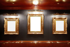 Gallery. With blank gold frames Stock Photos