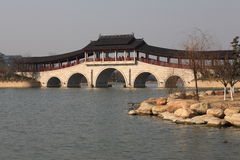 Gallery arch bridge. A traditional gallery arch bridge in a park built by the local government over taihu lake in the city of wuxi, jiangsu, china. raw available Stock Image