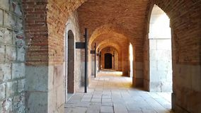 Gallery with arches in a brick structure. stock video