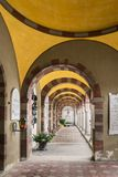 Gallery of arches and colonnade inside the cemetery of San Candi. San Candido, Italy - December 25, 2016: Gallery of arches and colonnade inside the cemetery of Stock Images