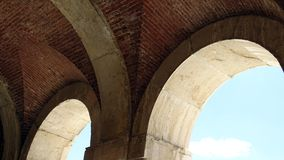 Gallery. Architectural detail of arches. Royal Palace of Aranjuez on a sunny summer day. Spain. The famous Palace of Aranjuez on a sunny summer day. Gallery Royalty Free Stock Photography
