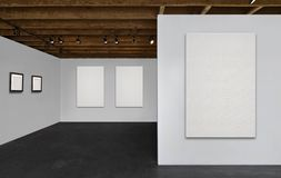 Gallery with blank canvases and empty frames. A gallery room with wooden ceilings, white walls, black floor, and 3 blank white canvases and 2 empty frames hung Stock Photos