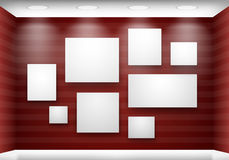 Gallery empty frames on red wall with lighting Stock Photography
