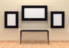 Gallery interior with table and empty black frames Royalty Free Stock Images