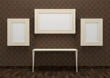 Gallery interior with table and empty white frames Royalty Free Stock Photo