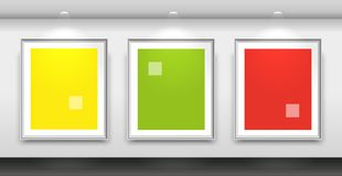 Gallery interior with three blank white frames on the wall. Vector Stock Photography