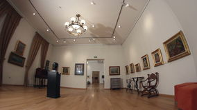 Gallery of paintings. Dolly shot. Tulcea - October 25: Tulcea Museum of Art in a 18th-century building on October 25, 2013 in Tulcea,Romania stock footage