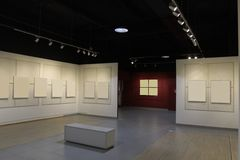 Gallery with pictures. Gallery with paintings on the white background Stock Photo