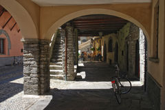 Gallery on street of small town Domodossola, Italy Stock Image