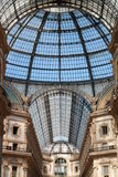 Gallery Vittorio Emanuele in Milan. Famous gallery in the Center of city with glass dome and steel beams structure beautiful perspective view Royalty Free Stock Images