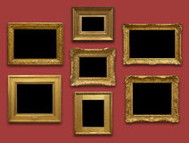 Gallery Wall Gold Frames. Antique gold frames on red background royalty free stock photo