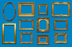 Gallery Wall with Gold Frames. Old gold antique picture frames with drop shadow on a blue background Royalty Free Stock Photos