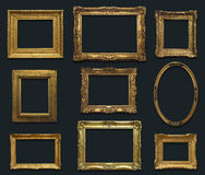Gallery Wall with Old Frames. Gold antique frames with drop shadow on a uniform dark gray background Stock Photos